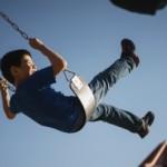 kidchildplayingplaygroundfunswingfreeskyfeaturedimage
